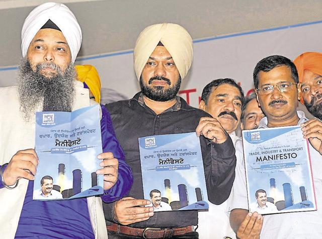 Delhi chief minister and Aam Aadmi Party national convener Arvind Kejriwal with other party leaders releasing the manifesto for trade, industry and transport in Ludhiana on Sunday.