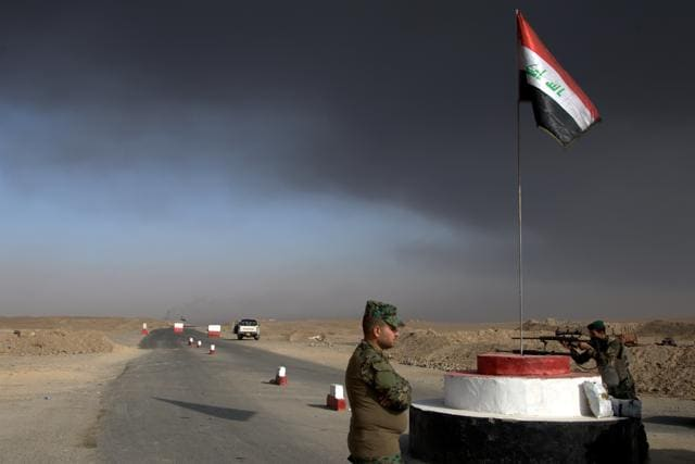 Iraqi forces fire artillery shells towardsKirkuk from their position on Islamic State (IS) group jihadists.