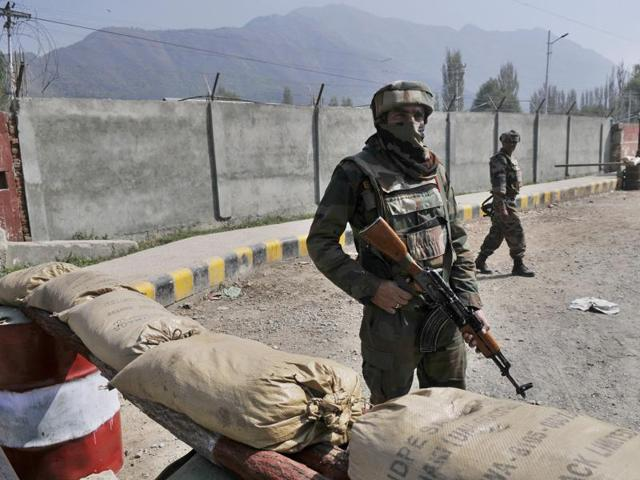 A soldier stands guard near a check post outside Badami Bagh cantonment of the Army in Srinagar.