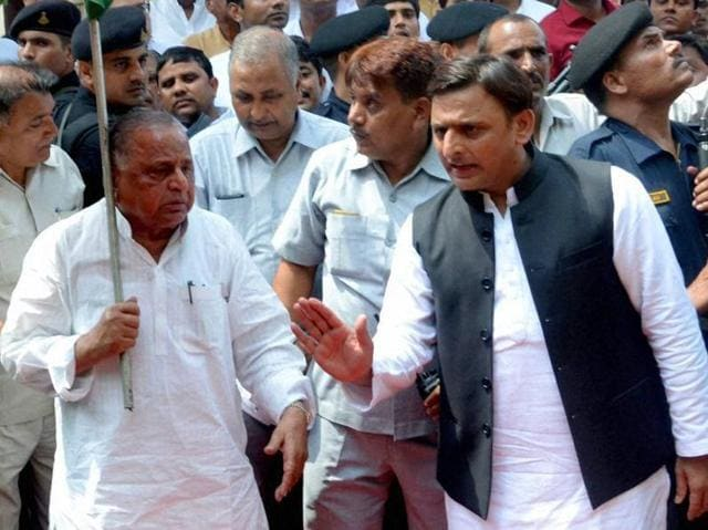 Samajwadi Party supremo Mulayam Singh Yadav, left,  and Uttar Pradesh chief minister Akhilesh Yadav.