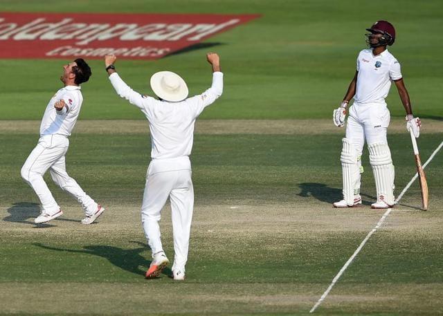 Yasir Shah of Pakistan celebrates dismissed Leon Johnson and Marlon Samuels on Monday.