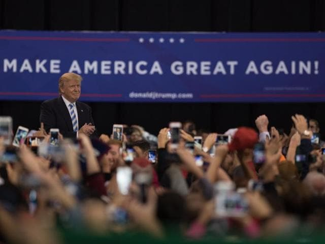 Republican presidential nominee Donald Trump greets supporters during a campaign stop at the International Exposition Center on October 22 in Cleveland, Ohio.