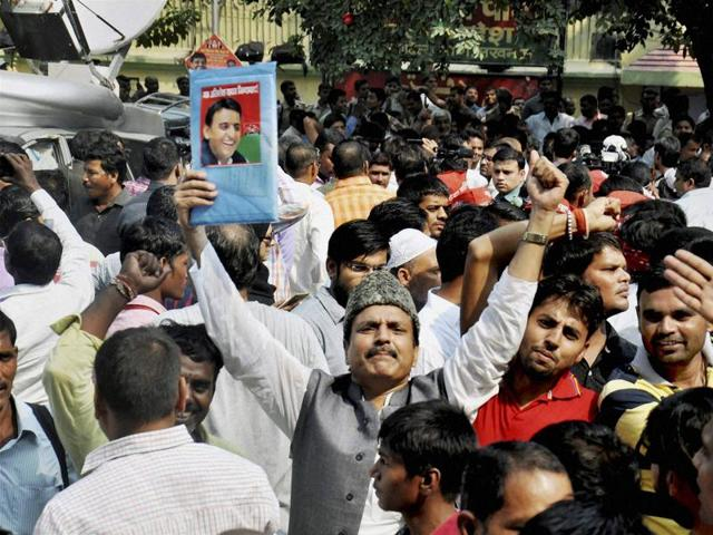 Supporters of Uttar Pradesh CM Akhilesh Yadav raise slogans at the party office where he was attending a meeting with party legislators along with SP supremo Mulayam Singh Yadav and party state  president Shivpal Yadav, in Lucknow.