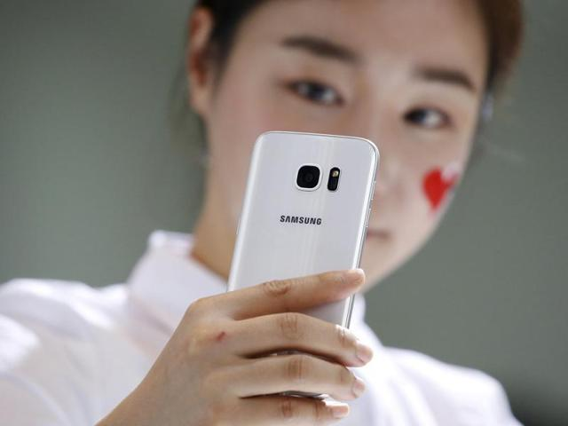 A model demonstrates a Samsung Electronics' new smartphone Galaxy S7 during its launching ceremony in Seoul, South Korea.
