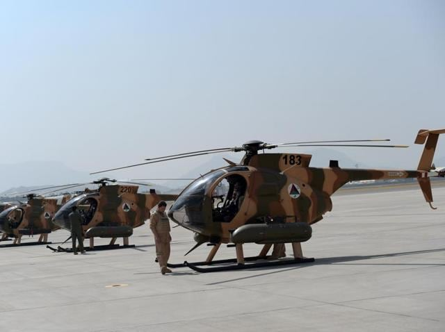 US-made MD-530 helicopters fly over the air force university in Kabul. Under pressure from the Taliban, Afghanistan's military is increasingly relying on the young air force and speeding up the training of pilots and ground controllers.