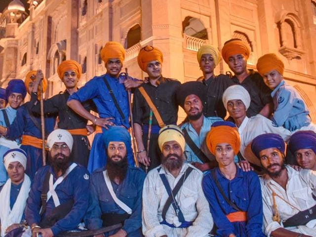 Gatka practitioners pose near the Golden Temple in Amritsar on Tuesday.
