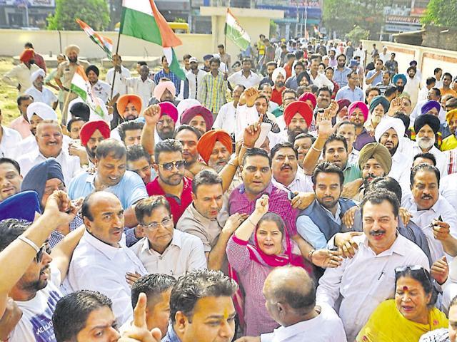 Amritsar district Congress urban unit raising slogans against mayor Bakshi Ram Arora and municipal officials outside the MC office in Ranjit Avenue on Monday.