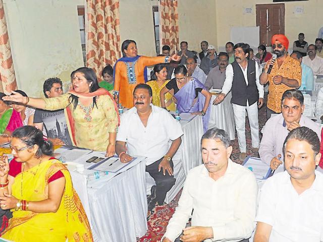 DMC board members trade barbs during a meeting in Dehradun on Tuesday.