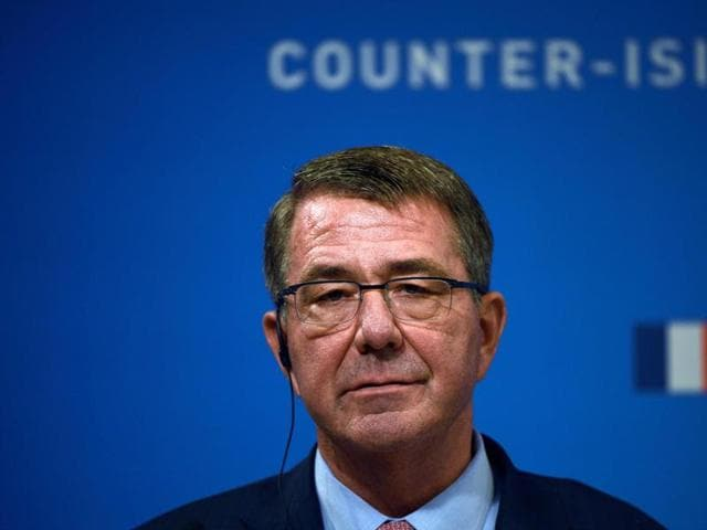 US Secretary of Defence Ashton Carter speaks as French Defence Minister listens on during a joint press conference following a meeting with ministers from 12 other countries in Paris.