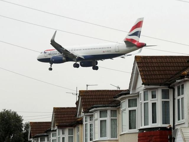 Residents of Harmondsworth protest against a third runway for Heathrow airport in London on Tuesday. Britain's government gave the go-ahead on Tuesday to build a new runway at Heathrow airport despite concerns about air pollution, noise and the destruction of homes in the capital's densely populated western neighbourhoods.