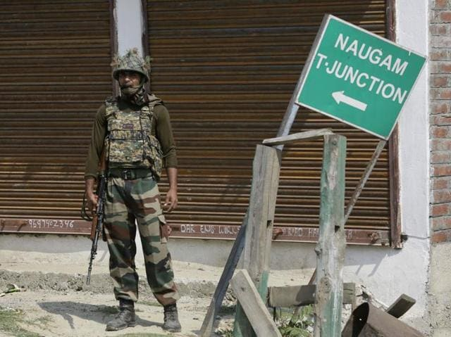 An Indian Army soldier stands guard at Nowgam sector, near the de facto border dividing Kashmir between India and Pakistan.