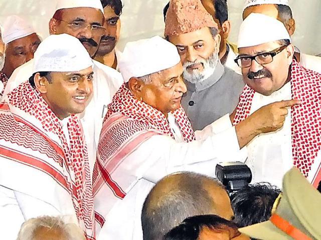 Samajwadi Party chief Mulayam Singh Yadav (centre) with Amar Singh (right) and UPchief minister Akhilesh Yadav (left) at an Iftar party.