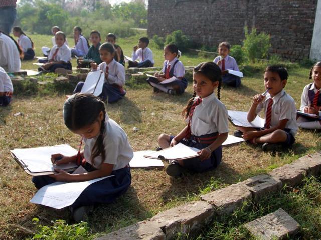 Children attend a school near the India-Pakistan international border in R S Pura on Monday.