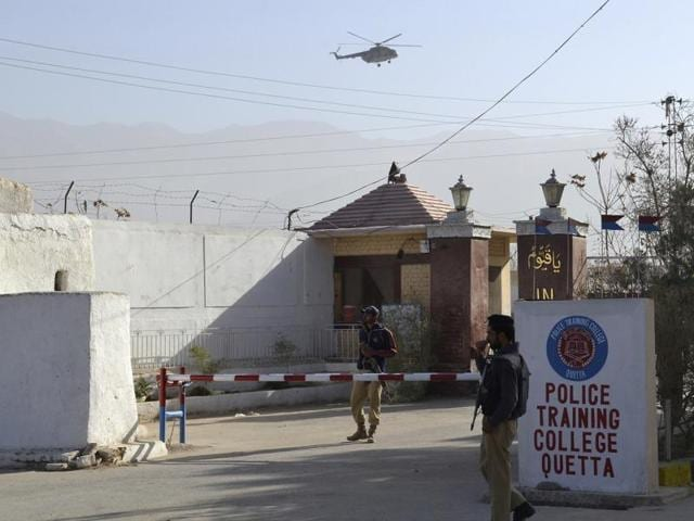 Pakistani police officers stand guard outside a police training center which was attacked by militants in Quetta on Tuesday night.