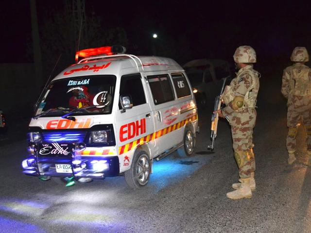 An ambulance carries injured officers to a hospital outside a police training school attacked by militants in Quetta.