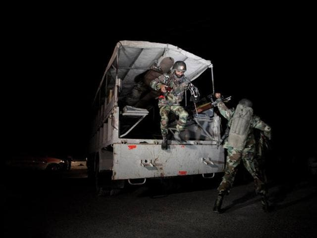 A police truck is seen at a gate to the Police Training Center after an attack on the center in Quetta, Pakistan.