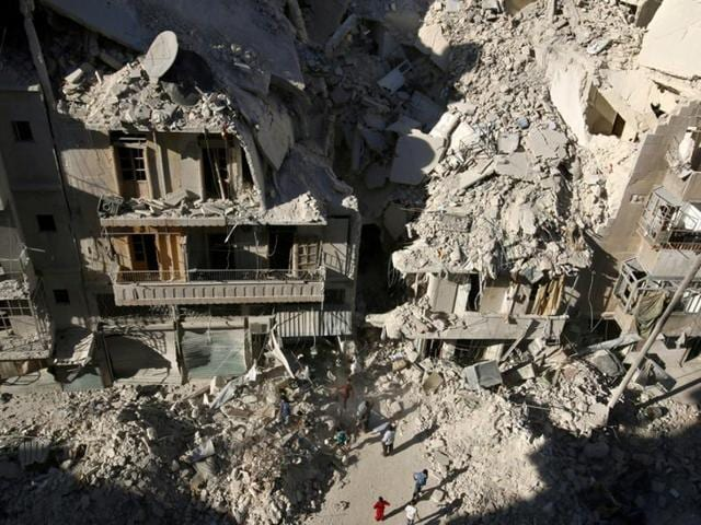 People dig in the rubble in an ongoing search for survivors at a site hit previously by an airstrike in the rebel-held Tariq al-Bab neighborhood of Aleppo, Syria.