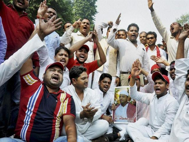 Supporters of Uttar Pradesh chief minister Akhilesh Yadav raise slogans outside party office, in Lucknow.