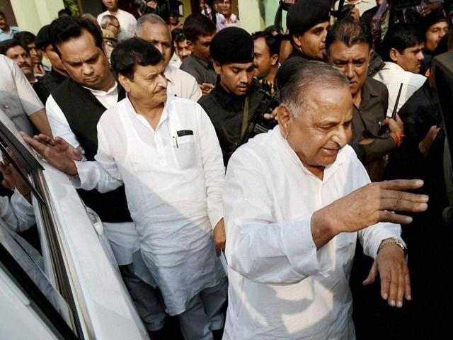 Samajwadi Party supremo Mulayam Singh Yadav with party's UP president Shivpal Yadav after a press conference at the party office in Lucknow on Tuesday.