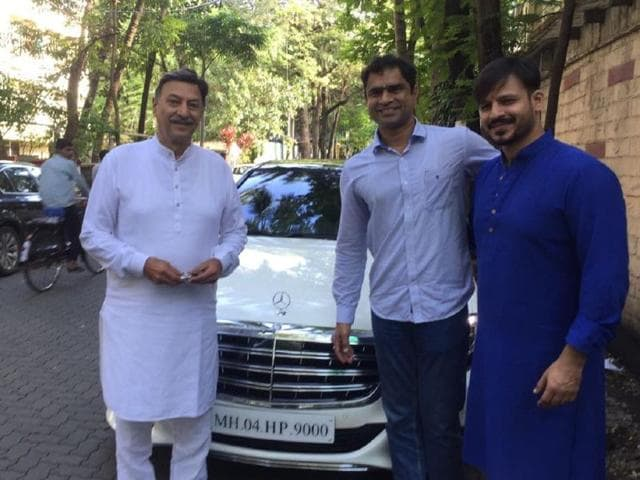 Suresh Oberoi and son Vivek Oberoi pose in front of their new car.