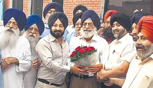 SAD workers greeting party's district president Surjit Singh Kohli in Patiala on Tuesday.