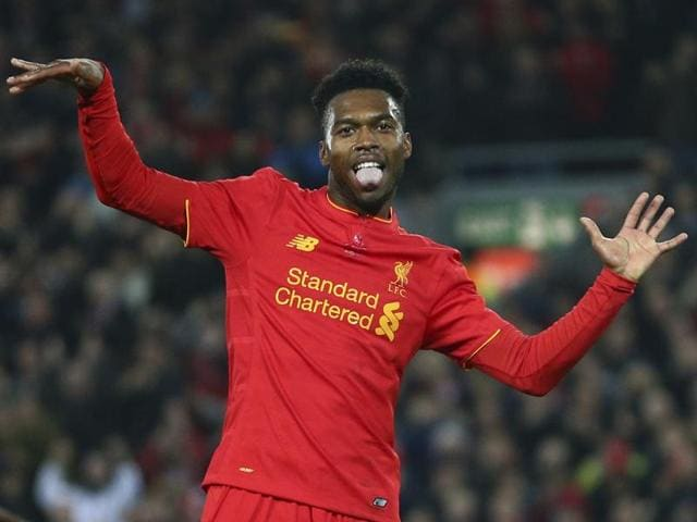 Daniel Sturridge (R) does his trademark celebratory jig after scoring Liverpool's second goal.