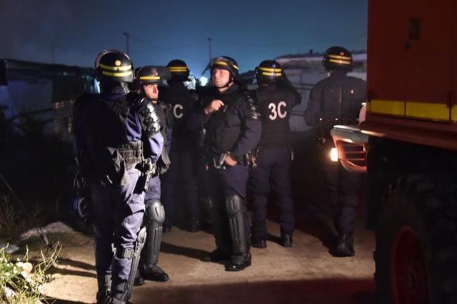 Anti-riot policemen patrol the Calais