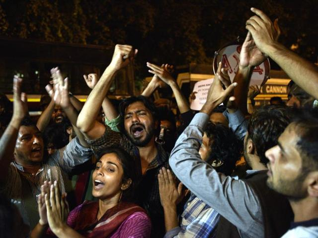JNU students protest on the issue of missing JNU Student Najeeb, causing a roadblock near Vasant Vihar Police Station in New Delhi on Wednesday