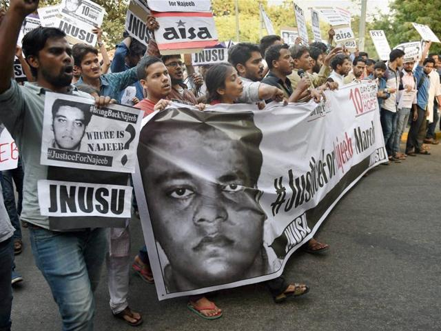 Members of JNUSU and other students' organisations shout slogans during a protest march over missing of student Najeeb Ahmed, in New Delhi on Monday.