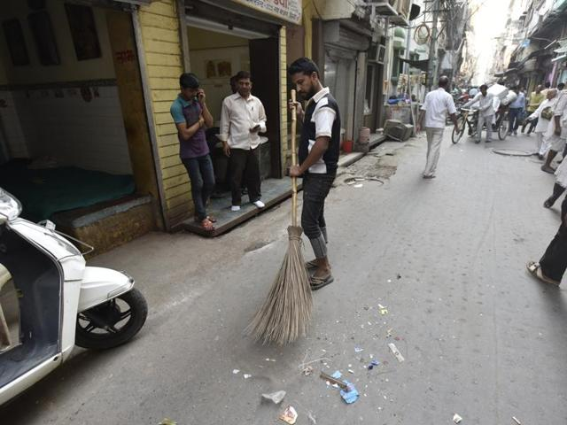 A sweeper cleans the blast spot in Naya Bazar.