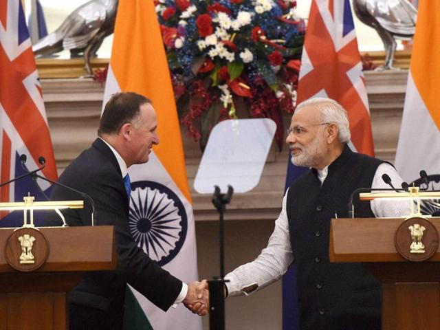 Prime Minister Narendra Modi greets the New Zealand PM John Key after their joint statement in New Delhi on Wednesday.