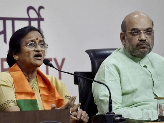 BJP president Amit Shah looks on as former UP Congress president Rita Bahuguna Joshi speaks to media after joining Bharatiya Janata Party at party headquarters in New Delhi last week.