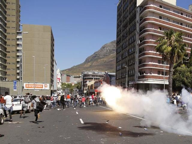 South African Policemen fire rubber bullets at student protestors in Cape Town, South Africa, Wednesday, Oct. 26, 2016.
