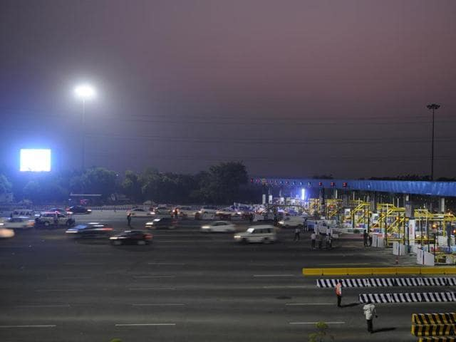 Vehicles move freely across the DND toll booth on Wednesday.