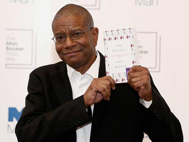 Paul Beatty poses for the media with his book