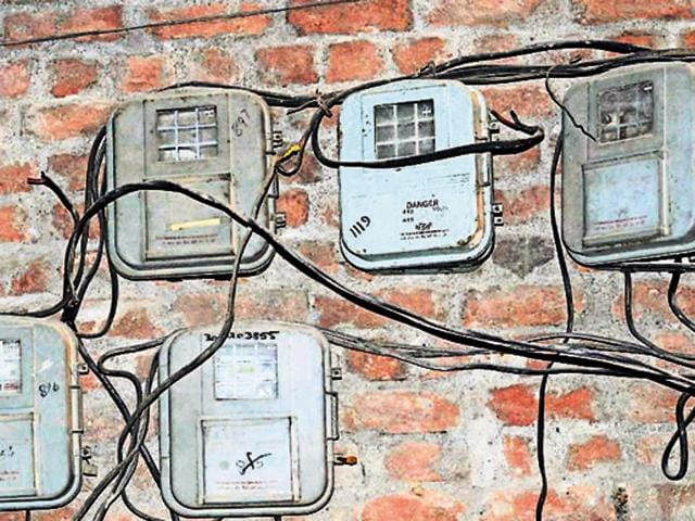 A view of electricity meters outside the residence at a colony in Jalandhar on Wednesday.