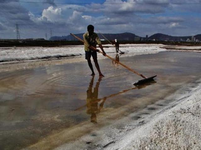 A worker at a salt pan in Mulund.