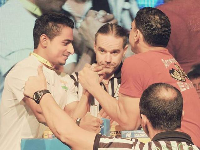 Para-arm wrestler Srimant Jha in action at the 19th World Para-Arm Wrestling  Championship.