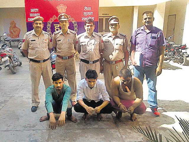Three accused of posing as cow vigilantes and attempting extortion in police custody at Dharuhera.