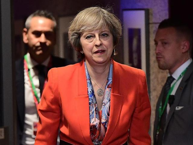 British Prime Minister Theresa May looks on as she leaves the European Union leaders summit in Brussels.