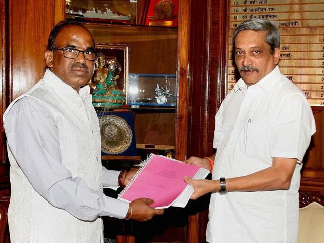 Justice L Narasimha Reddy, chairman of the Judicial Committee on OROP, handing over the report to the defence minister Manohar Parrikar in South Block, New Delhi on Wednesday.