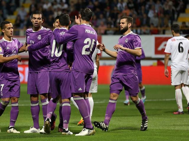 Real Madrid players celebrate their opening goal.