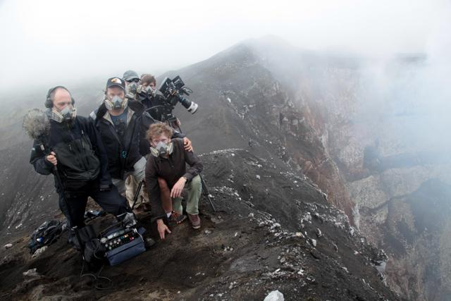 The crew gazes Into The Inferno in a production still from Werner Herzog's new documentary. (Netflix)
