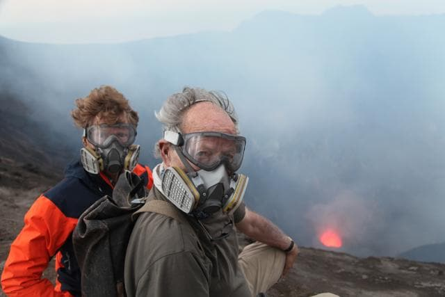 Werner Herzog and Clive Oppenheimer (L), take a peek Into The Inferno. (Netflix)