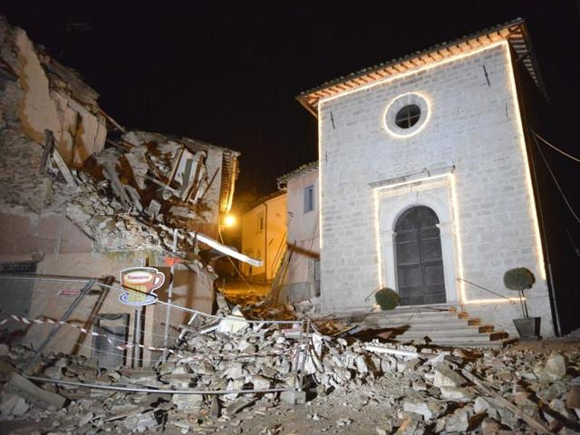 A view of the Church of San Sebastiano amid damaged houses in Castelsantangelo sul Nera, Italy, following an earthquake.