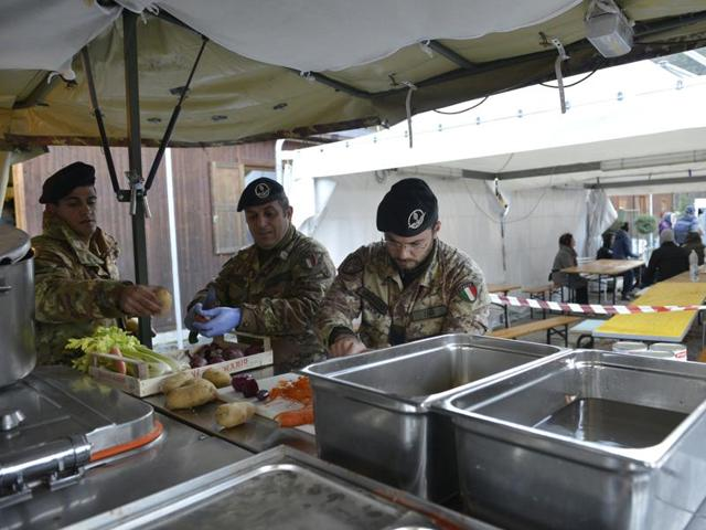 Soldiers prepare meals for residents of the village of Visso, Italy, Thursday, Oct 27, 2016 after a 5.9 earthquake destroyed part of the town.