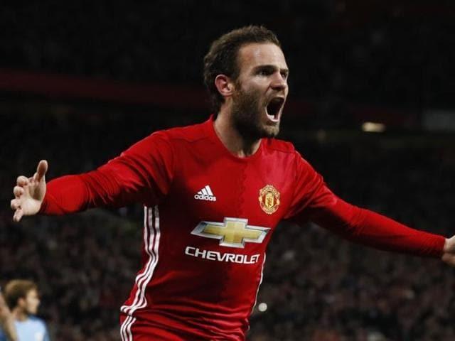 Juan Mata celebrates after scoring.