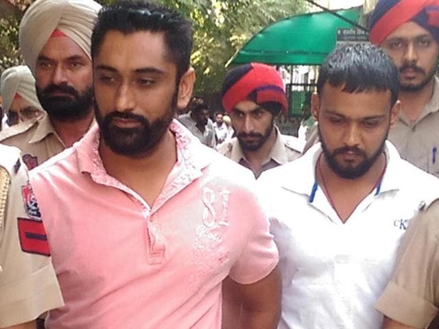 Police with the acid attack victim's husband Harinder Singh (pink T-shirt) and others outside a Moga court on Wednesday.