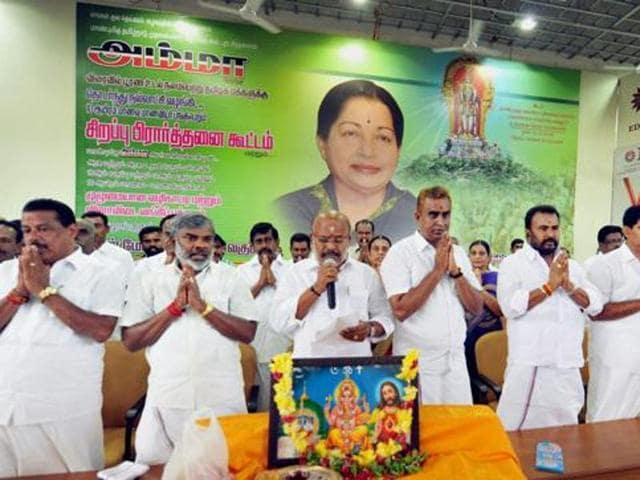AIADMK members and school students offer a group prayer for the speedy recovery of Tamil Nadu chief minister J Jayalalithaa, in Coimbatore.