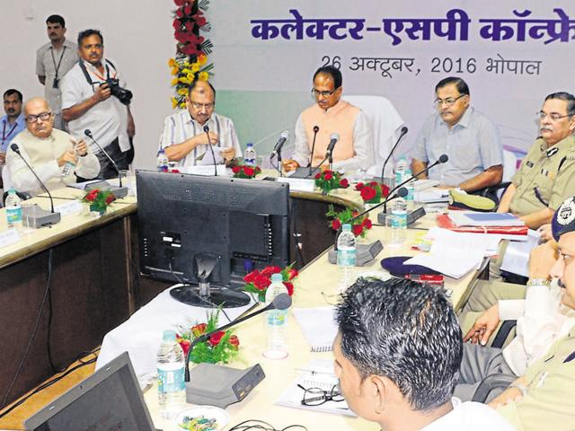 Chief minister Shivraj Singh Chouhan (3rd from left) addresses a conference of superintendents of police and collectors in Bhopal on Wednesday.